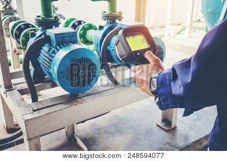 Technician Thermography Servicing An Water Motor Cooling Tower In Factory