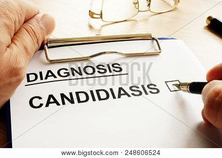 Doctor Is Holding Form With Diagnosis Candidiasis.