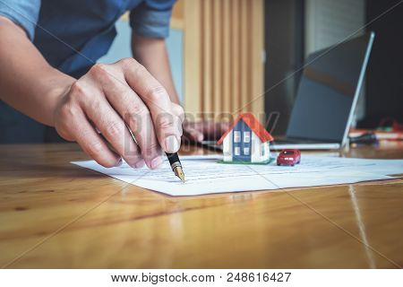 Real Estate Agents  And Client To Agree Buy A Home And Sign Documents Contract House With Customer A