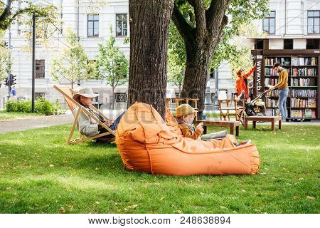 Vilnius, Lithuania 06 July 2018: Vilnius Is Reading. People Reading Book In Open Air Reading Room In