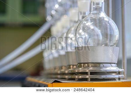 Soxhlet Extractor.Percolator-boiler and reflux,distillation flask on heating element.Organic chemistry class.Pharmacy Extraction poster