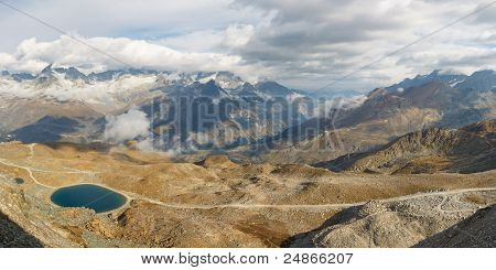 Panoramic view of high alpine scenery from Gornergrat near Zermatt Switzerland. poster