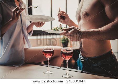 Close Up. Young Couple Have Dinner And Drink Red Wine. Romantic Dinner In Modern Kitchen. Romantic D