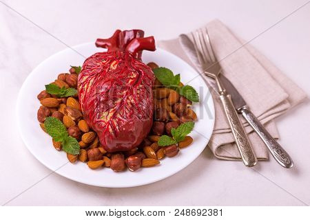 Healthy Food And Heart Model. Nuts And Berries. Medical Abstract Concept