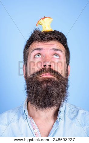 Live Target Concept. Man Handsome Hipster Long Beard Almost Eaten Apple Stump On Head As Target. Hip