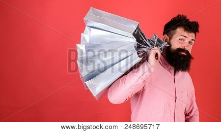 Hipster On Cool Face Is Shopping Addicted Or Shopaholic. Guy Shopping On Sales Season With Discounts