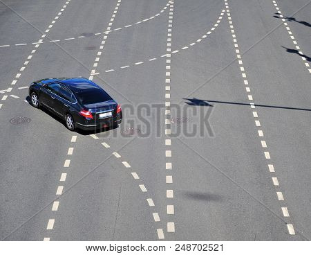 MOSCOW, RUSSIA - JULY 02: Top view of the black car turning on highway, Moscow on July 2, 2018.