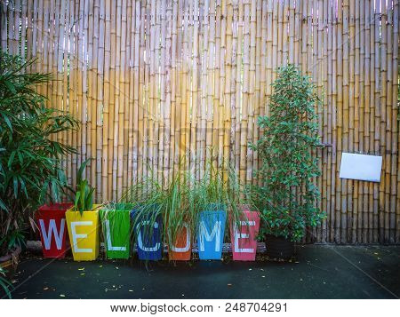 Welcome Sign And Bamboo Wall In The Park,welcome And Bamboo Wall