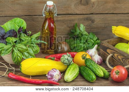 Many Delicious Juicy Fresh Colorful Summer Vegetables And Herbs On Dark Wooden Background. Close Up,