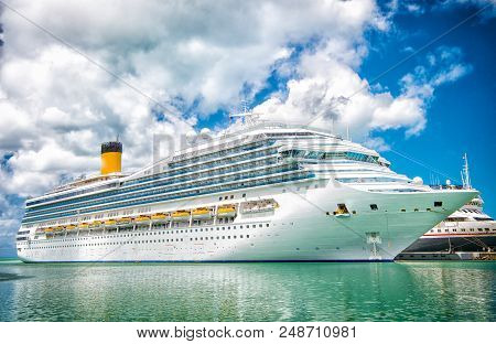 Cruise Ship At Sea Dock In Turquoise Sea. Travelling By Sea On Cruise Ship. Water Transport Of Cruis