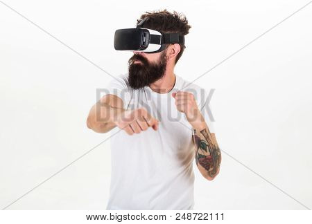 Man With Beard In Vr Glasses Fighting, White Background. Vr Gadget Concept. Guy With Head Mounted Di