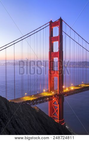The North Tower Of The Iconic Golden Gate Bridge Stands Tall Backed By The City Of San Francisco Jus