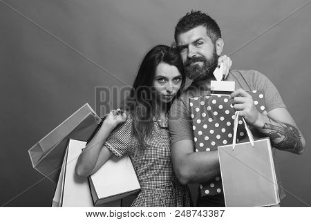 Shopping And Fashion Concept. Bearded Man Holds Shopping Bag And Box. Guy With Beard And Pretty Lady