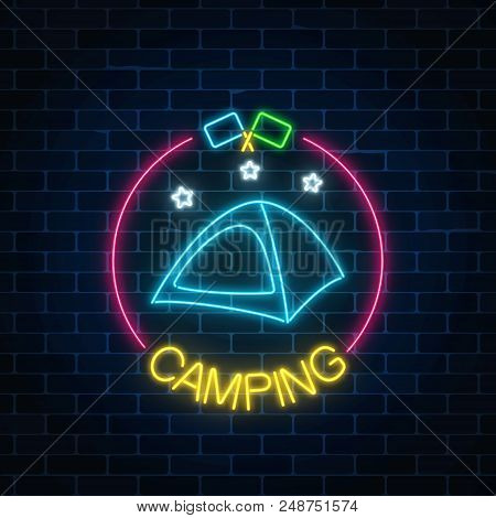 Neon Camping Sign With Tent, Stars And Flagsin Circle Frame On Dark Brick Wall Background. Glowing W