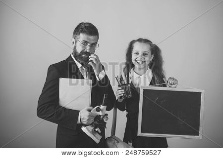 Preparation For School. Man And Girl In School Uniform. Home Schooling And Back To School Concept. F