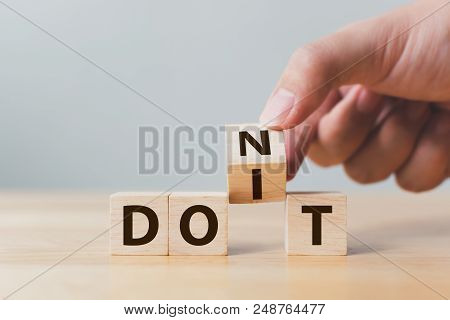 Hand Flip Wooden Cube Block With Word Don't Change To Do It. Personal Development And Career Growth