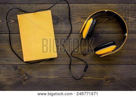 Books Online Concept, Audiobooks. Spend Leasure Time Reading And Listening Music. Headphones Near Ha