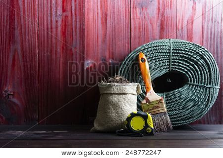 Craftsman Tool Such As String Rope, Paint Brushes, And Old Nails In Sacks.