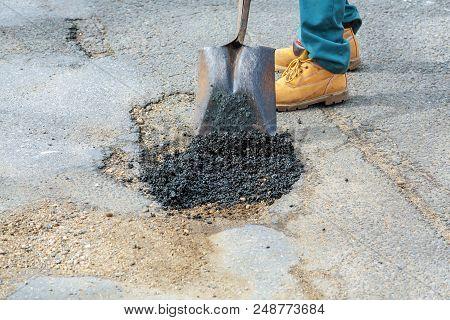 Asphalt Paving Street resurfacing. Fresh asphalt construction. Bad road poster