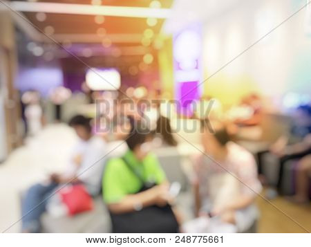 Blurred Images Abstract Background Of People Waiting Bank Teller Cashier Counter Service On Seat  In