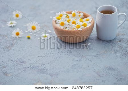 chamomile tea with fresh flowers - healthy lifestyle