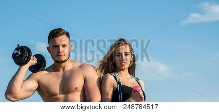 Fitness. Fitness Training On Blue Sky. Fit Man And Woman With Fitness Tools Outdoor. Fitness Trainer