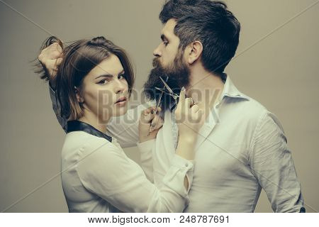 Beard care tricks keep facial hair look resplendent. Masculinity concept. Girl barber with scissors cutting beard hair brutal bearded hipster. Beard makes your appearance more masculine and brutal. poster