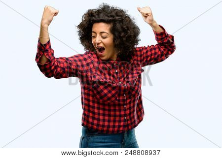 Beautiful arab woman happy and excited celebrating victory expressing big success, power, energy and positive emotions. Celebrates new job joyful