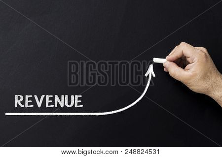 Growing Revenue Concept. Businessman Draw Accelerating Line Of Improving Revenue
