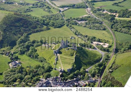 Aerial View Of Corfe Castle And The Village Of Corfe