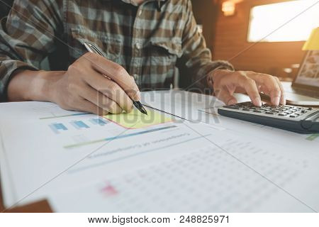 Business, Finance, Tax And People Concept - Close Up Of Man Hands Counting Financial Document With C