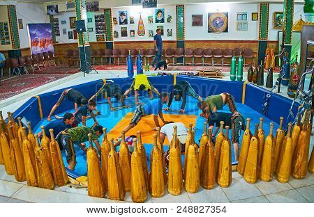 Kerman, Iran - October 16, 2017: Athletes Of Different Age And Physical Form Train In Zurkhaneh (hou