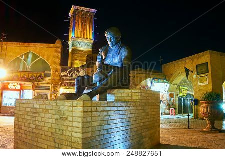 Kerman, Iran - October 16, 2017: The Monument To Coppersmith Next To Ganjali Khan Complex With The S