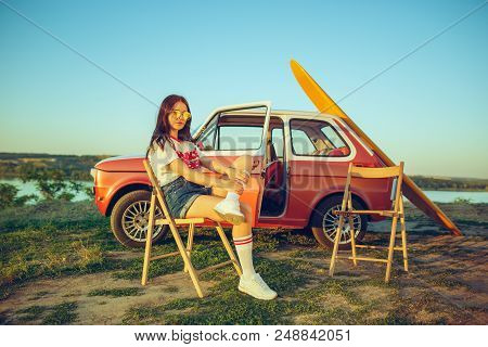 Woman And Happy Trip By Car. Laughing Girl Sitting In The Car While Out On A Road Trip Near River. S