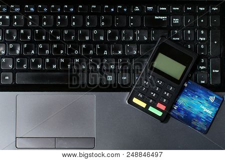 Bank Card And Payment Device Lying On Keyboard, Top View. Concept Of Internet Crime, Hacking, Cyber