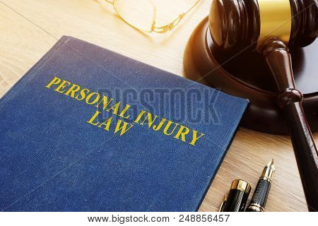 Personal Injury Law On A Desk And Gavel.