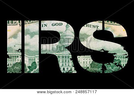 Tax Money. Irs Sign Made With Paper United States Money On Dark Background. Revenue Service, Finance