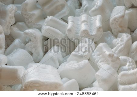 Polystyrene or white styrofoam packing for protection of damage to fragile objects during shipping. poster