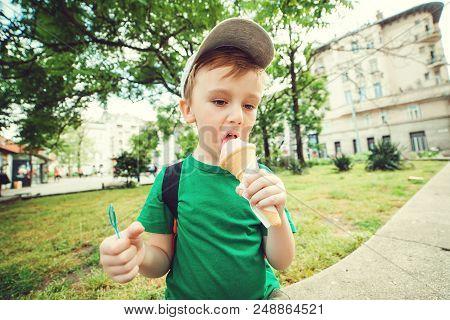 Toddler Boy Eating Ice Cream. Happy Kid Enjoying Ice-cream In Summer Day. Summer Holidays.