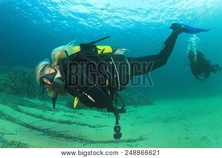Blonde female scuba diver