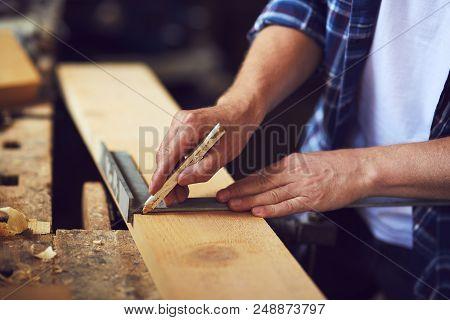 A Carpenter Uses A Framing Square