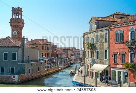 Murano, Italy - April 25, 2008:  The Fondamente Dei Vetrai Canal With The Town Clock Tower In The Ba