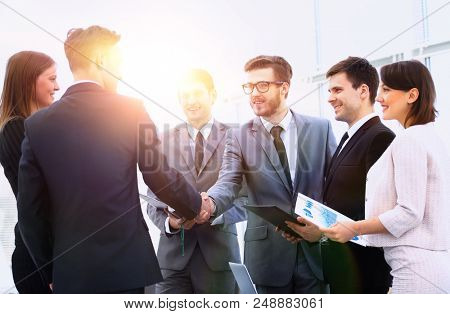welcome and handshake of business partners on the briefing