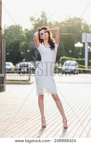 Girl With Long Hair In Elegant White Dress