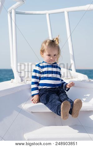 Explore World. Child Cute Sailor On Yacht Sunny Day. Adventure Of Boy Sailor Travelling Sea. Boy Ado
