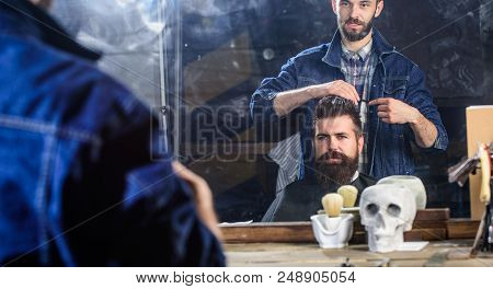 Man With Beard And Mustache In Hairdressers Chair In Front Of Mirror Background. Hipster Client Gett