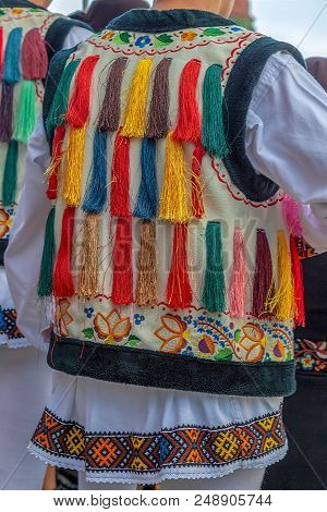 Detail Of Romanian Folk Costume For Man With Multi Colored Embroidery. Specific For Bistrira-nasaud