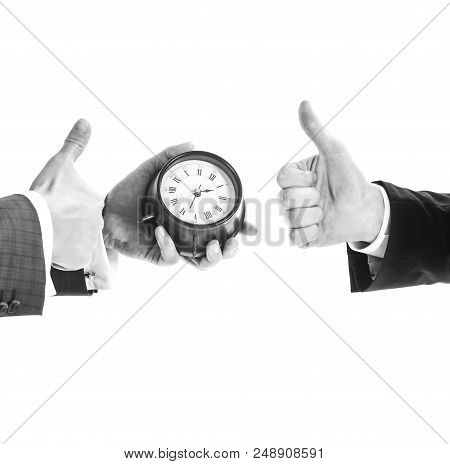 Male Hand In Suit Holds Clock, Copy Space. Time Management Concept. Hands Of Two Caucasian Men With