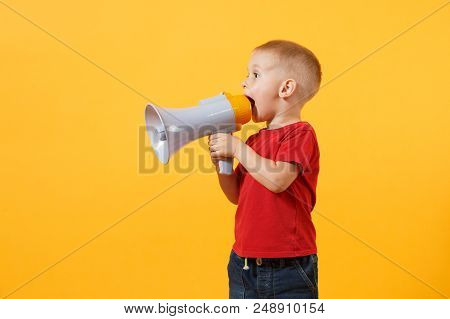 Little Cute Kid Baby Boy 3-4 Years Old In Red T-shirt Holding In Hand And Speaking In Electronic Gra