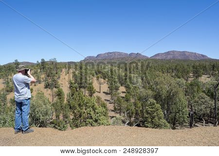 Flinders Ranges, South Australia, Australia - March 15, 2018: Middle Aged Male Tourist Photographing